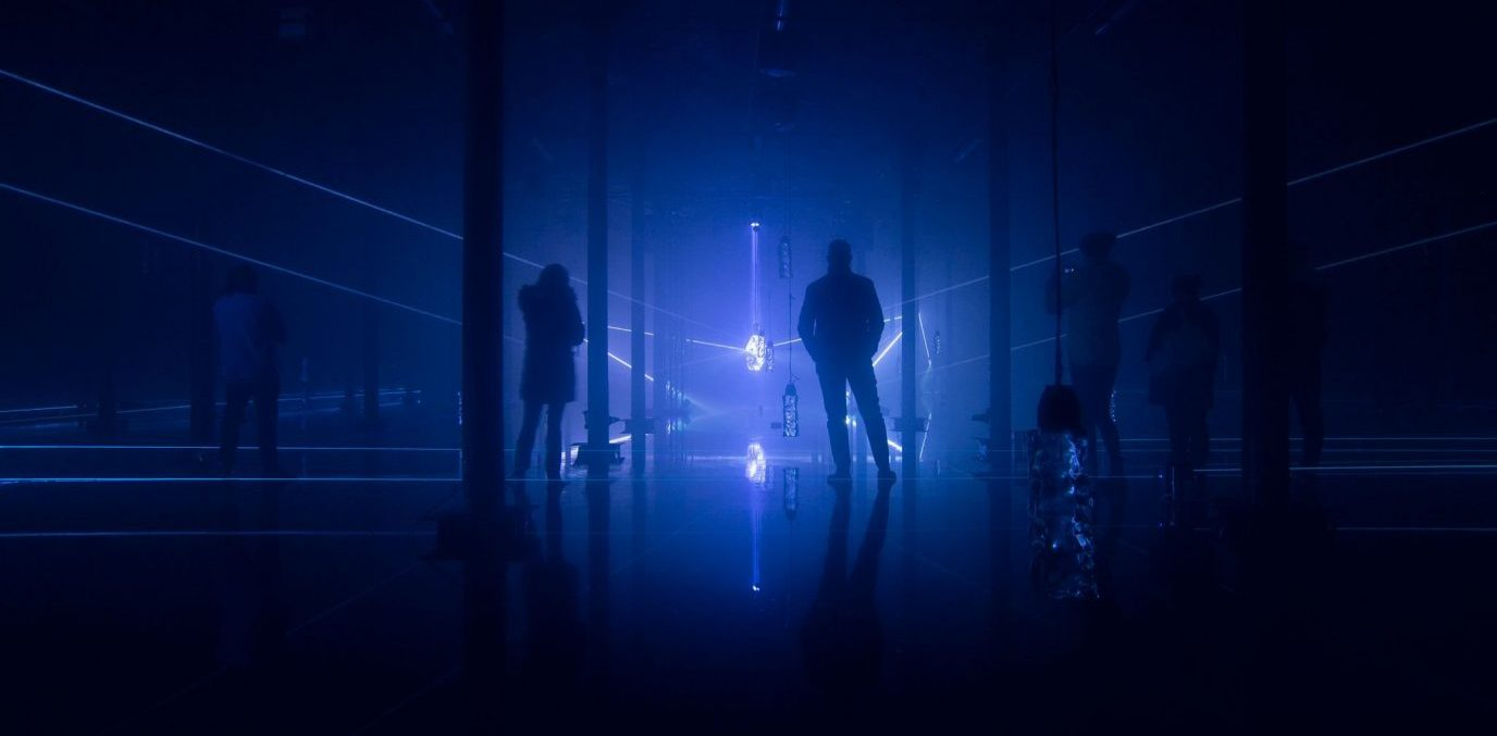' ` '  Visitors explore Aurora, a large immersive installation staged in Liverpool's Toxteth Reservoir by FACT and Liverpool City Council