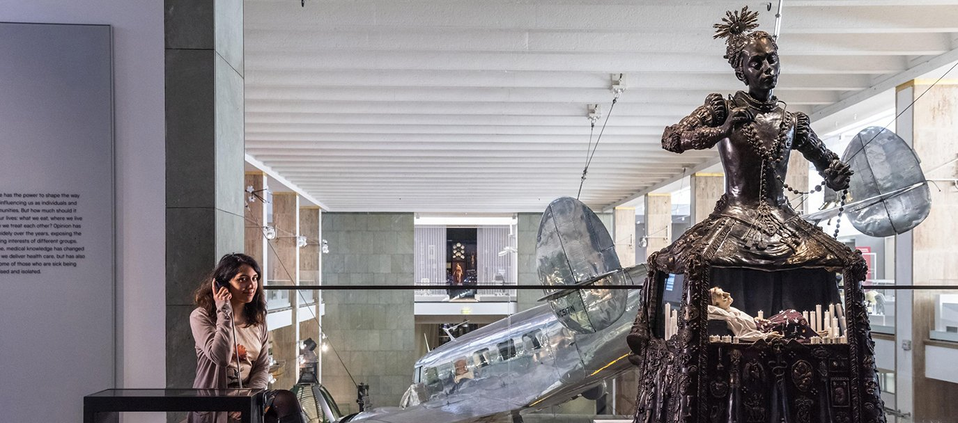 A visitor in the Faith, Hope and Fear gallery at the Medicine Galleries, which opened in November 2019 at the Science Museum, London