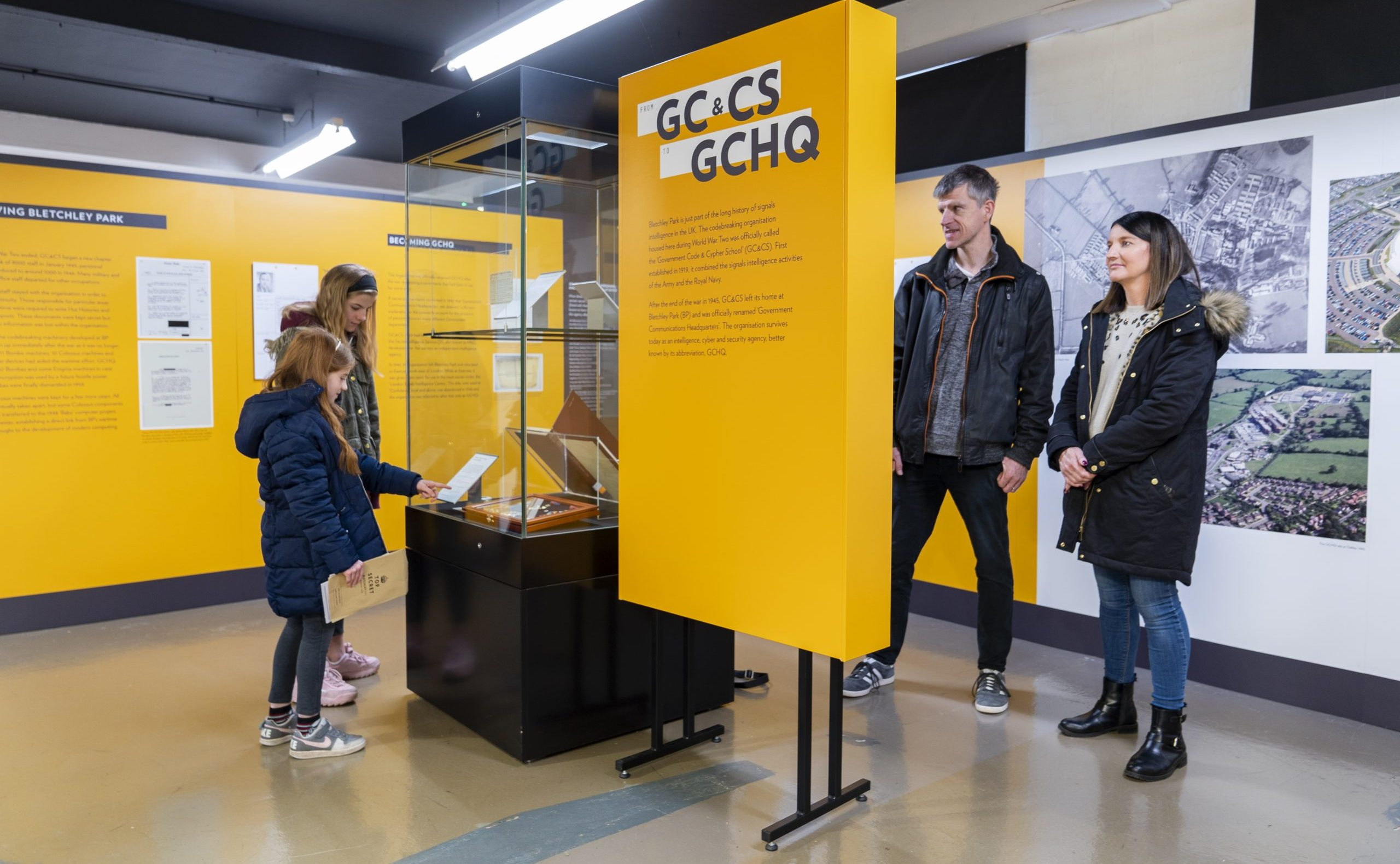 Visitors at the GCandCS To GCHQ exhibition at Bletchley Park Trust