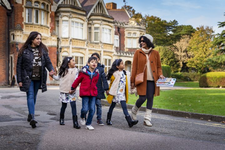 A family group visiting Bletchley Park in Milton Keynes