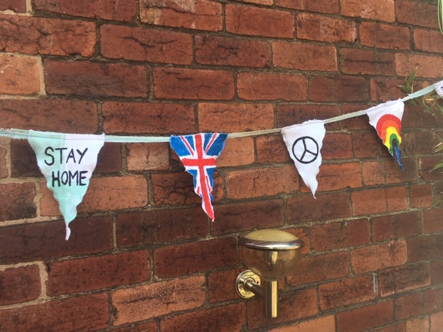 "VE day homemade ""Stay Home"" bunting which was donated to Museums Sheffield"