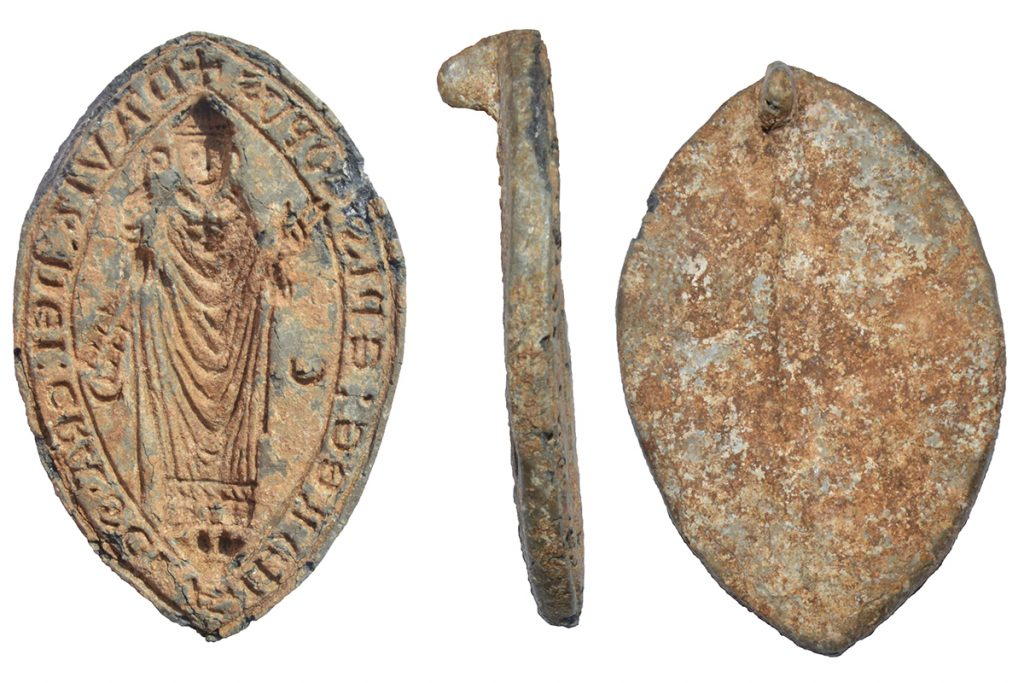 A lead alloy seal shown from different angles