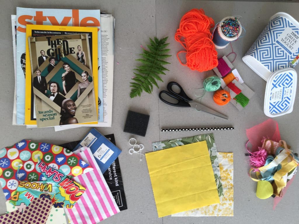 Scissors, paper, and craft materials on a table