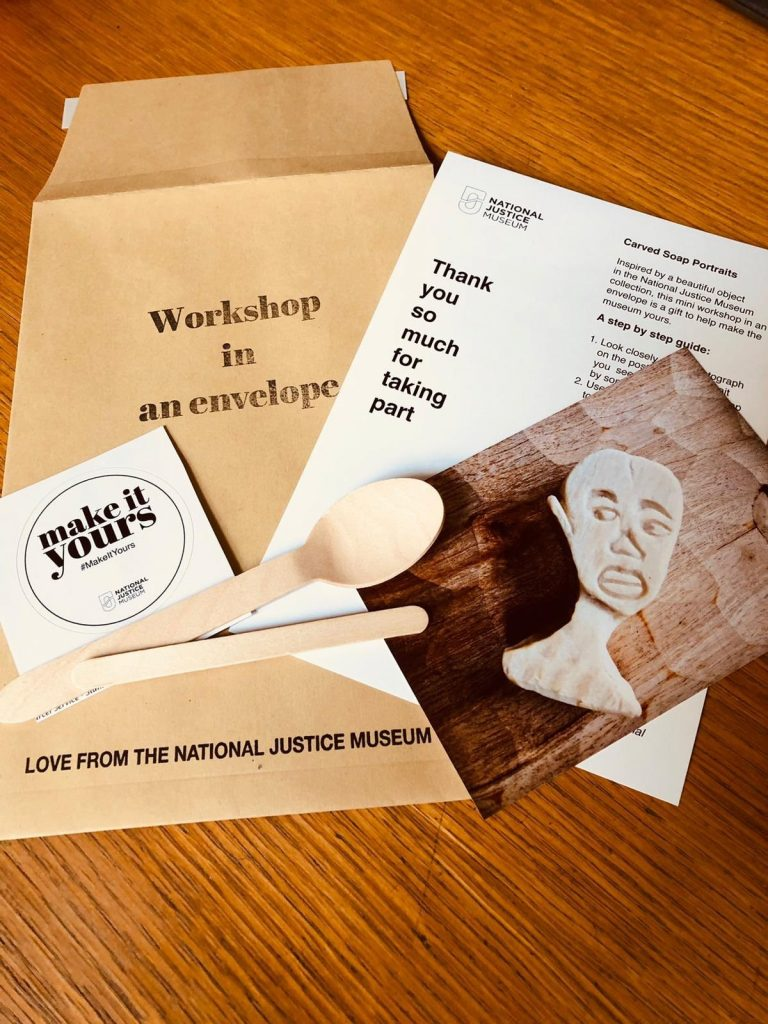 Paper, a spoon, and instructions for 'Workshop in an Envelope'