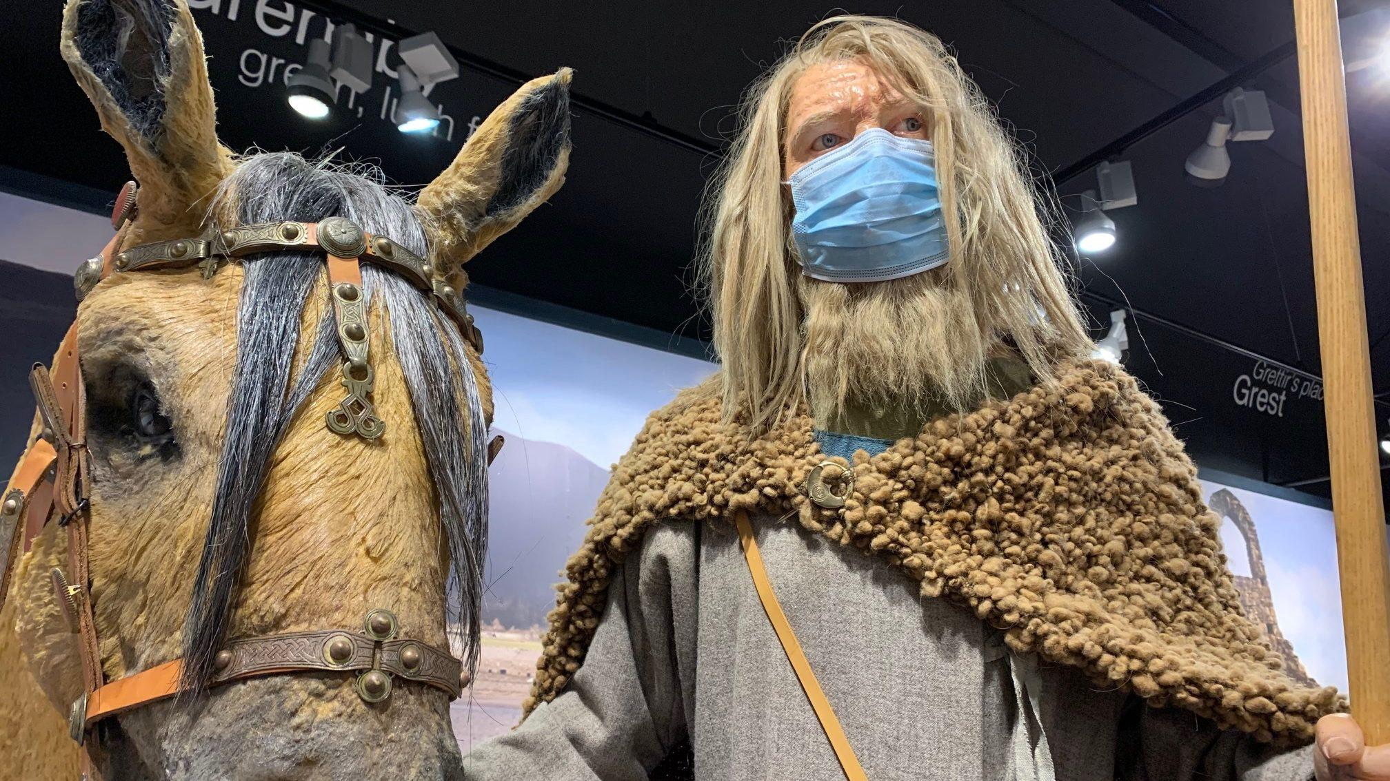 A Manx Museum Viking demonstrates how to wear a PPE mask