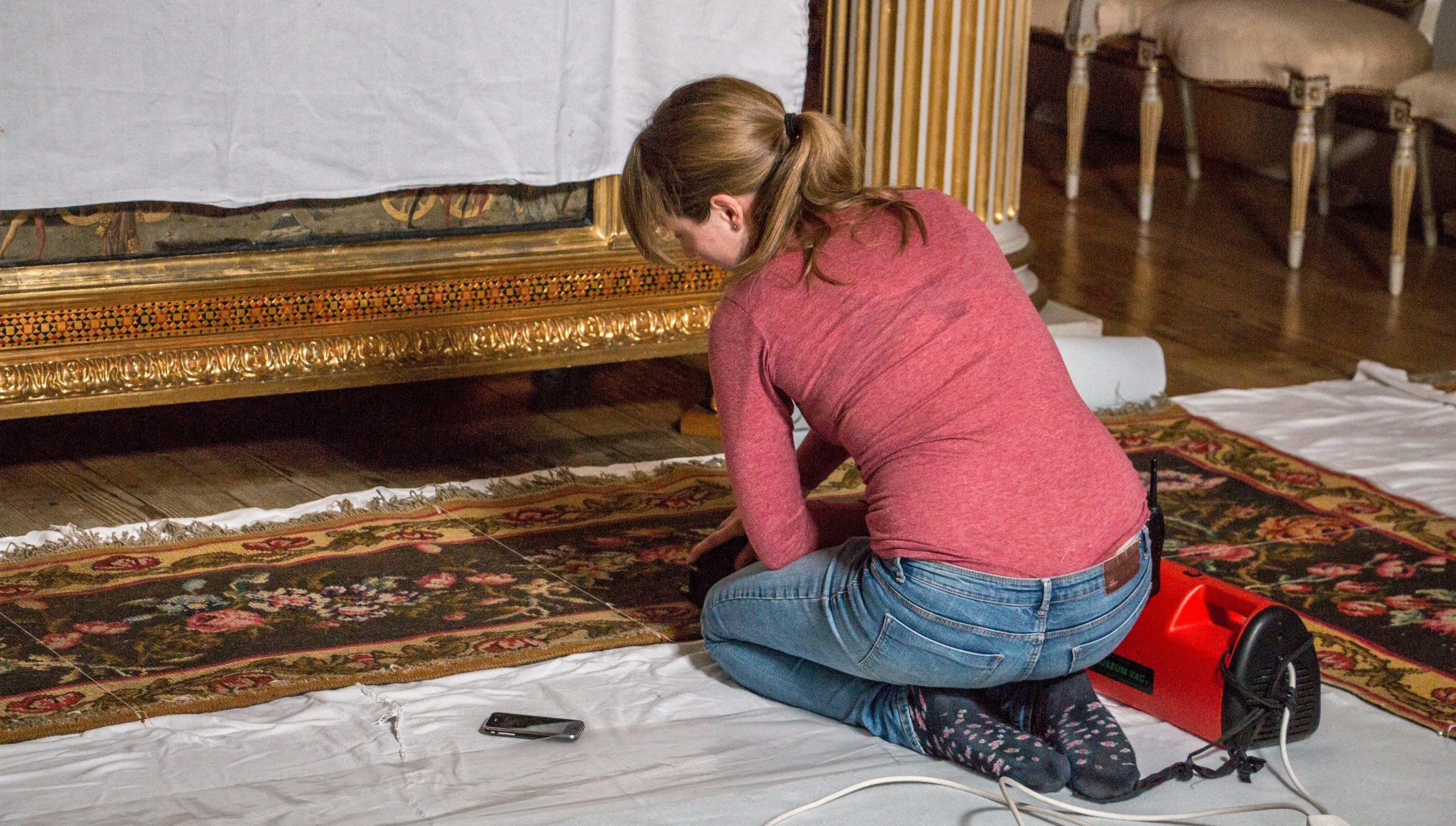 House steward Ellie Hobbs cleans the state bedroom carpet at Blickling Hall in Norfolk, where the trial will take place