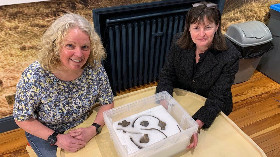Finder Kath Giles (left) and Allison Fox with the artefacts