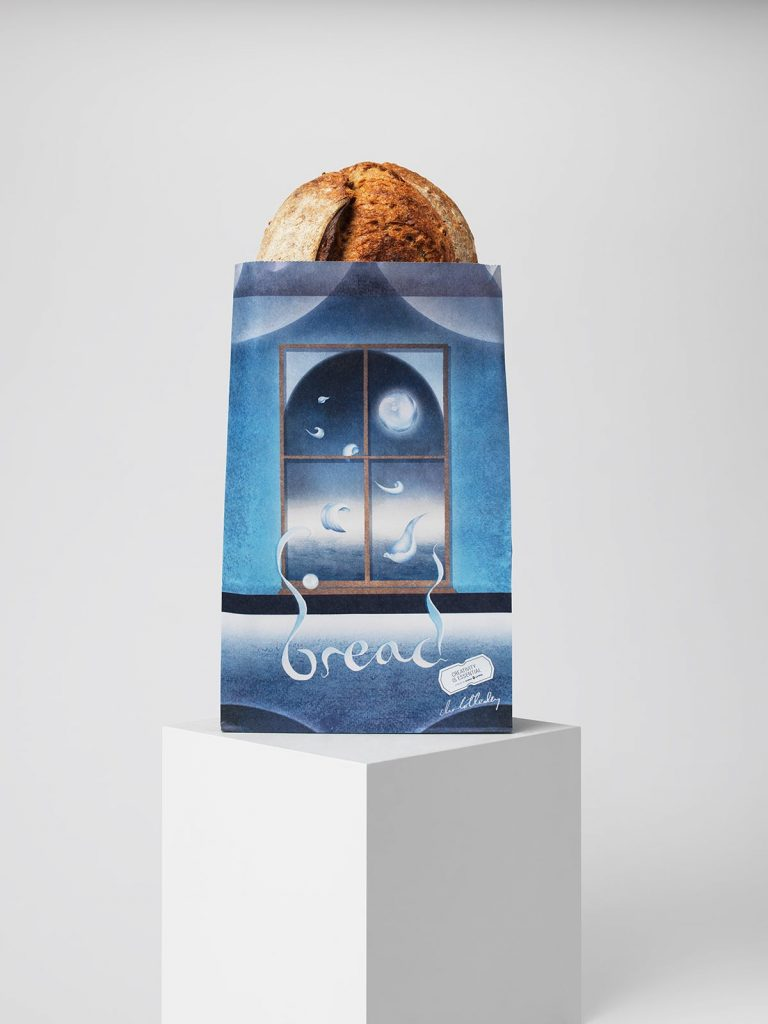 A bread bag illustrated by Charlotte Edey. There is a window and we can see out of it into the sky. She has used shades of blue to show its night time and the moon. There are floating white petals which move from inside to outside. It looks wispy.