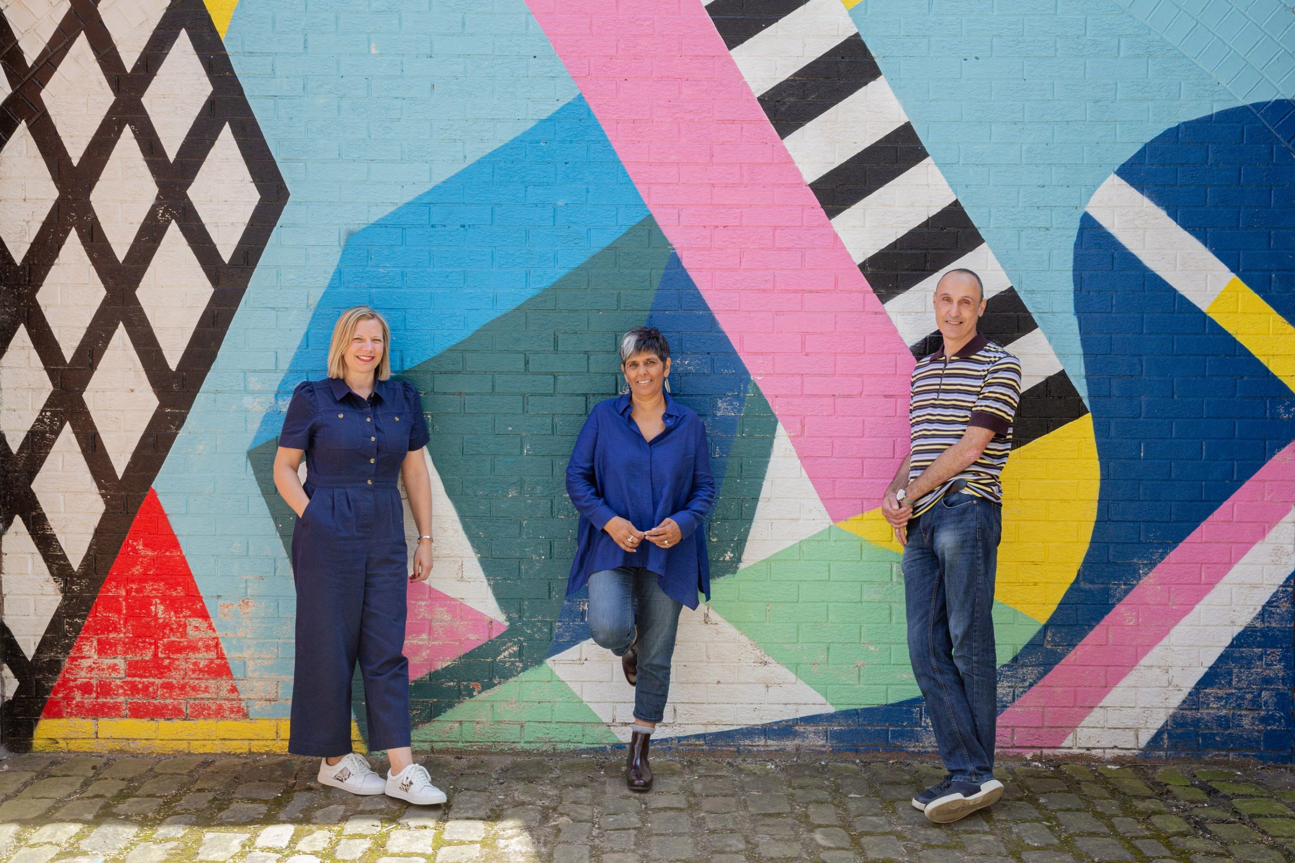 The Leeds 2023 team, from left to right: Abigail Scott Paul, director of external relations; Kully Thiarai, creative director/CEO; Mark Hollander, executive director
