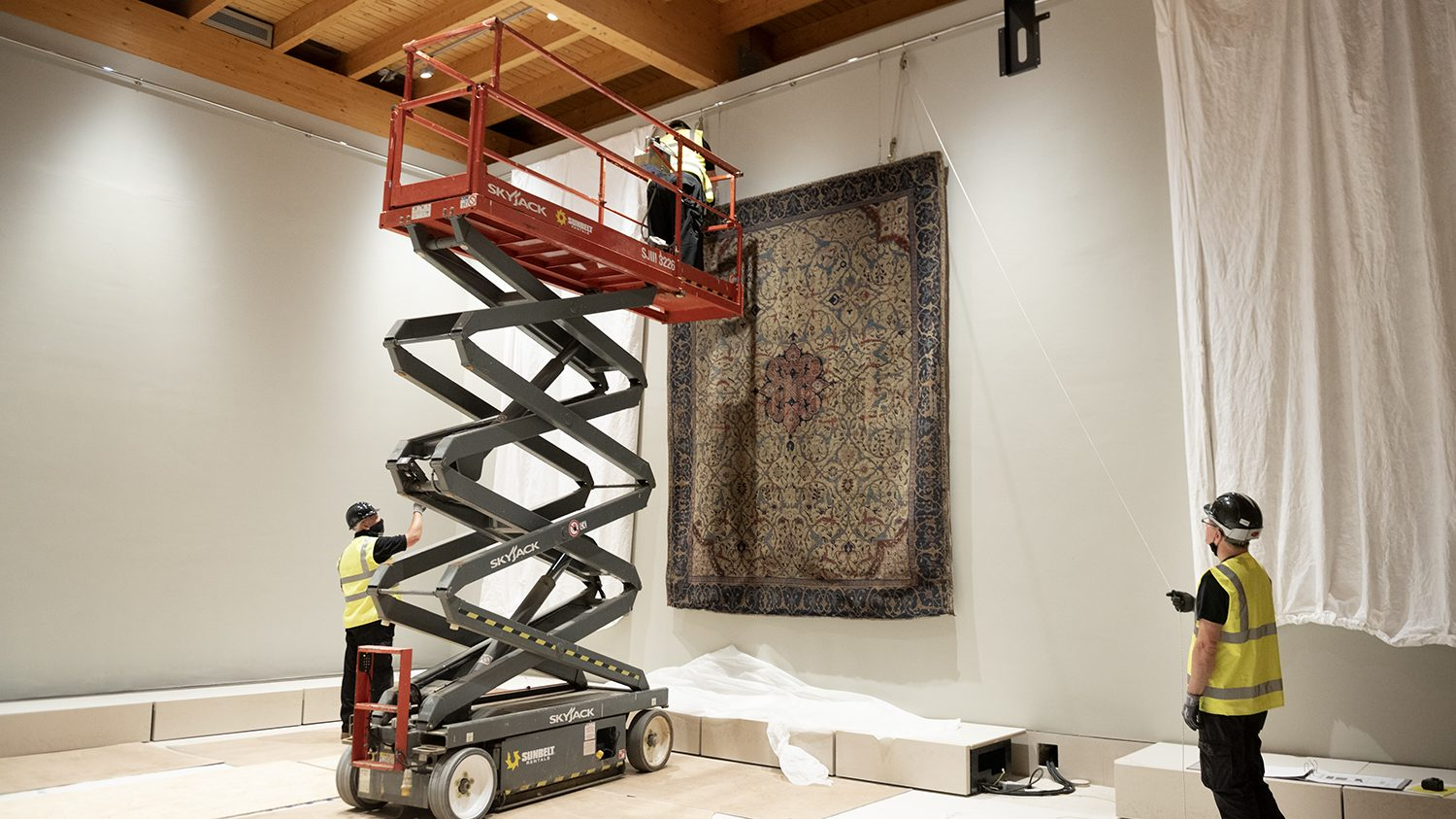 The Burrell Collection's Arabesque carpet being installed